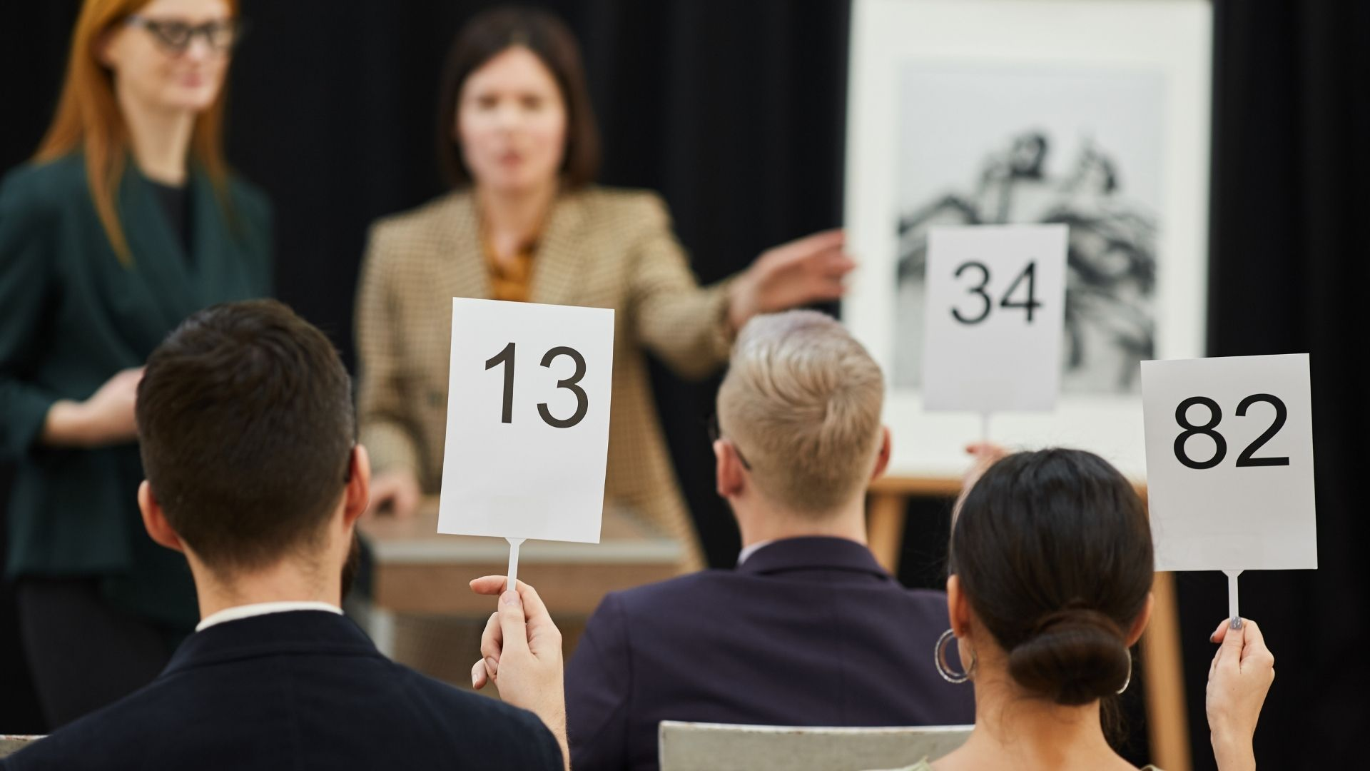 Photo of a typical art auction.