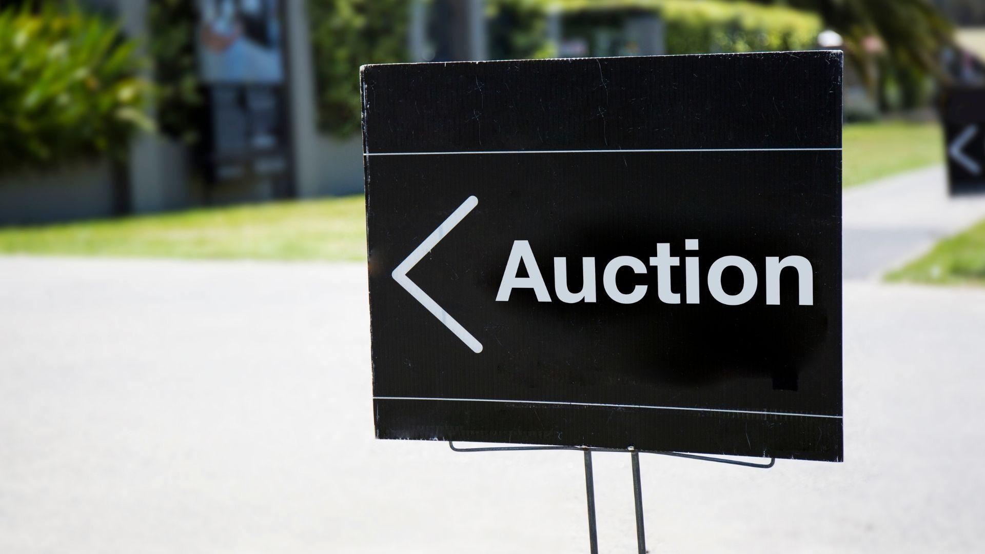 A neighborhood auction sign